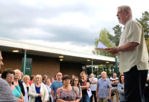 "Doug Sheddy speaks to a crowd opposing the adoption of ""High School FLASH"" in July at Batt"