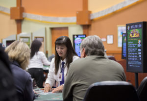 Dealer Sandy Pham looks over cards while assisting players at The Last Frontier Casino. The casino h