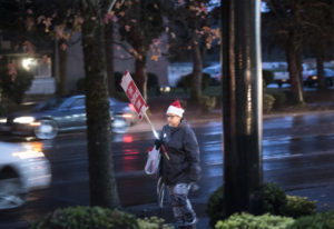 Kelly Olson, a paraeducator at Hazel Dell Elementary School, walks during a rally in front of the Va