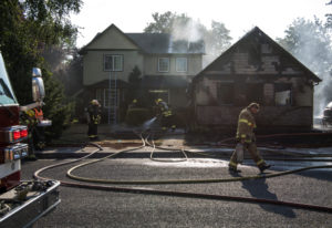 Vancouver Fire Department and Clark County Fire District 6 work a July fire at 11906 N.E. 40th Ave.
