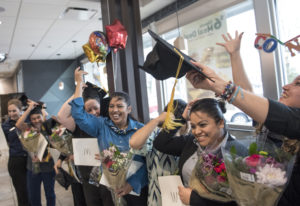 English Under the Arches graduates celebrate following a ceremony on Monday at the McDonald's at 281