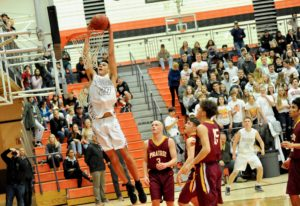 Battle Ground sophomore Kaden Perry finishes a two-handed dunk as Prairie players Kam Osborn, Gabe L