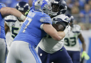 Seattle Seahawks defensive tackle Poona Ford, right, is blocked by Detroit Lions offensive guard Fra