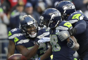 Seattle Seahawks wide receiver Jaron Brown, center, celebrates with wide receiver David Moore, left,