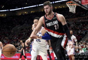 Portland Trail Blazers center Jusuf Nurkic, right, and Philadelphia 76ers guard Ben Simmons, left, g