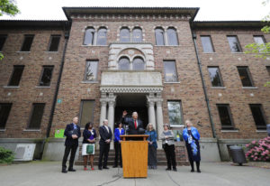 File - In this May 11, 2018 file photo, Washington Gov. Jay Inslee, center, speaks in front of Weste