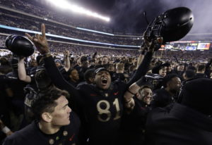 Army's Ke'Shaun Wells celebrates after an NCAA college football game against Navy, Saturday, Dec. 8,