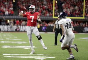 Ohio State quarterback Dwayne Haskins (7) throws as Northwestern defensive back Alonzo Mayo (10) def