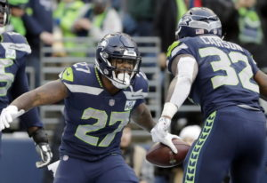 Seattle Seahawks' Mike Davis (27) celebrates his touchdown with Chris Carson during the second half
