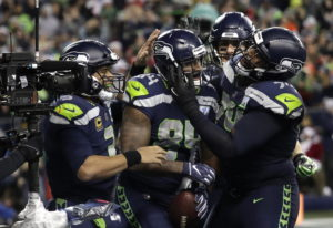 Seattle Seahawks tight end Ed Dickson, second from left, celebrates with quarterback Russell Wilson,