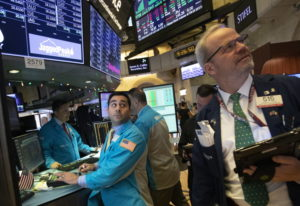 William Geier, Jr., left, and David O'Day work at the New York Stock Exchange, Tuesday, Dec. 11