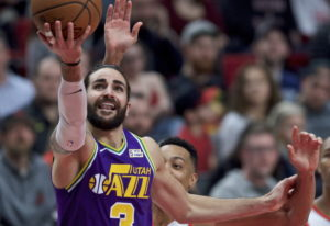 Utah Jazz guard Ricky Rubio shoots in front of Portland Trail Blazers guard CJ McCollum during the s