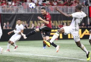 Atlanta United midfielder Miguel Almiron (10) has a shot defended by Portland Timbers defender Larry