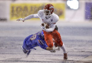 Fresno State wide receiver Derrion Grim (7) is tripped up by Boise State linebacker Tyson Maeva (58)
