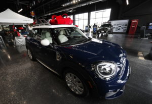 A large red bow to mark the holiday season sits on the roof of an unsold 2019 Countryman on the floo