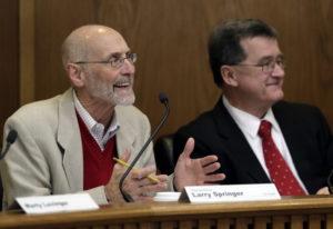 Rep. Larry Springer, D-Kirkland, left, co-chair of the Legislative Task Force on Public Records, spe
