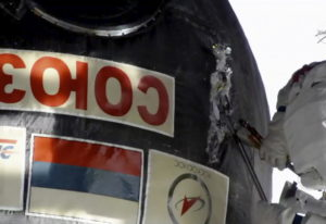 In this image from video made available by NASA, Russian cosmonaut Oleg Kononenko cuts into the insu