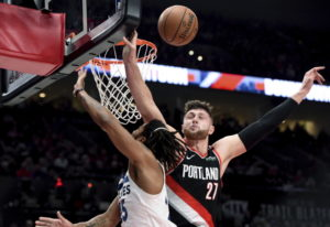 Portland Trail Blazers center Jusuf Nurkic, right, blocks the shot of Minnesota Timberwolves guard D