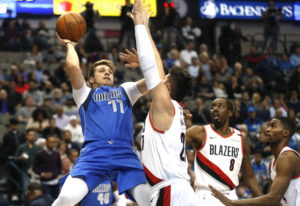 Dallas Mavericks forward Luka Doncic (77) attempts a shot over Portland Trail Blazers center Jusuf N
