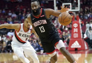 Houston Rockets' James Harden (13) drives past Portland Trail Blazers' CJ McCollum (3) during the fi