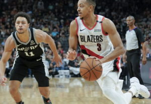 Portland Trail Blazers' C.J. McCollum (3) drives around San Antonio Spurs' Bryn Forbes during the se