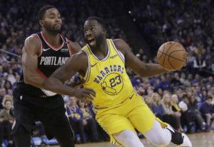 Golden State Warriors forward Draymond Green (23) drives to the basket against Portland Trail Blazer