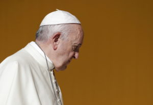 Pope Francis arrives Sept. 15 in Piazza Armerina, Sicily. Below: Pope Francis appears during his wee