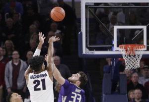 Gonzaga forward Rui Hachimura (21) shoots the go-ahead basket while defended by Washington's Sam Tim