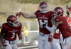 Eastern Washington quarterback Eric Barriere (3) celebrates a touchdown with Jayce Gilder (89) durin