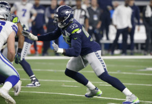 Seattle Seahawks defensive end Frank Clark (55) defends against a rush by the Dallas Cowboys during