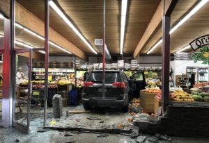 An SUV sits stopped amid what was part of Camas Produce's fruit selection after its driver, who