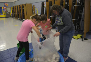 Washougal: Gause Elementary School students Parker Forsberg and Kamea Roy, from left, help Ellen Lan