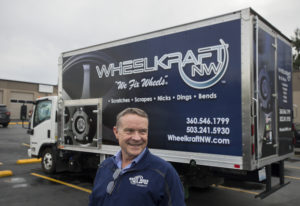 Pat Heffron, owner of WheelKraft NW, stands in front of one of the company's 10 mobile service truck