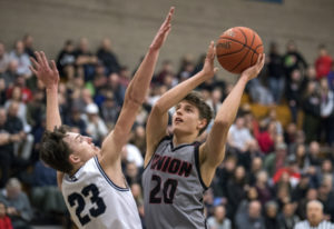 Skyview's Kyle Gruhler (23) jumps to block Union's Josh Reznick (20) during Tuesday night's game at
