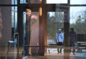 Clark College President Bob Knight speaks Thursday while students walk past during the annual State