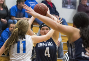 King's Way's Kira Zook (4) looks to pass Thursday night in La Center. King's Way defeated La Center