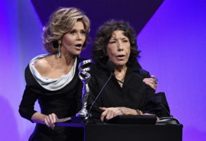 Presenters Jane Fonda, left, and Lily Tomlin address the audience during the 19th annual Costume Des