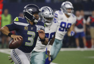 Seattle Seahawks quarterback Russell Wilson (3) runs out of the pocket against the Dallas Cowboys du
