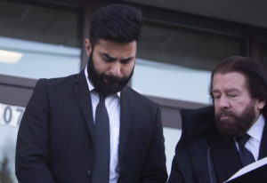 Jaskirat Singh Sidhu leaves provincial court with his lawyer Mark Brayford, right, in Melfort, Saska