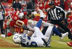 Kansas City Chiefs wide receiver Tyreek Hill (10) scores a touchdown past Indianapolis Colts safety