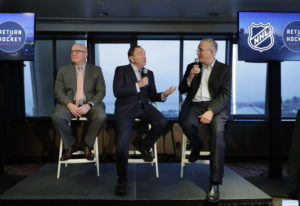 NHL Commissioner Gary Bettman, center, joins Deputy Commissioner Bill Daly, left, and Tod Leiweke, r