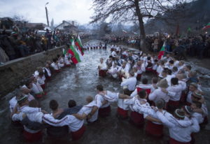 Bulgarians sing and chaindance in the icy waters of the Tundzha river in Kalofer, Bulgaria, Sunday,