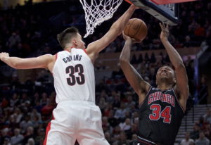 Chicago Bulls forward Wendell Carter Jr., right, shoots over Portland Trail Blazers forward Zach Col
