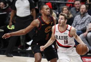 Portland Trail Blazers forward Jake Layman, right, drives against Cleveland Cavaliers guard Rodney H