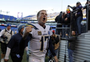 Los Angeles Chargers quarterback Philip Rivers celebates as he walks off the field after an NFL wild