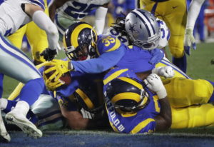 Los Angeles Rams running back C.J. Anderson scores against the Dallas Cowboys during the first half