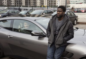 "Bryan Cranston, left, and Kevin Hart in a scene from ""The Upside."" David Lee/STXfilms"