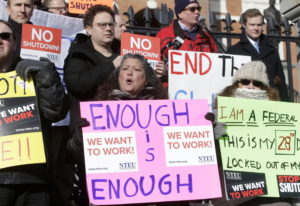Internal Revenue Service employees, front row from the left, Brian Lanouette, of Merrimack, N.H., Ma