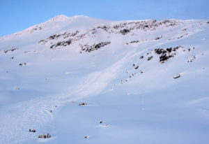 Rescuers, at bottom left, work at the scene of an avalanche Thursday near the northern city of Troms