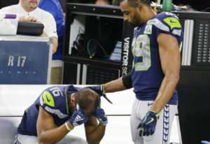 Seattle Seahawks wide receiver Tyler Lockett (16) is consoled by Doug Baldwin (89) after their NFC w